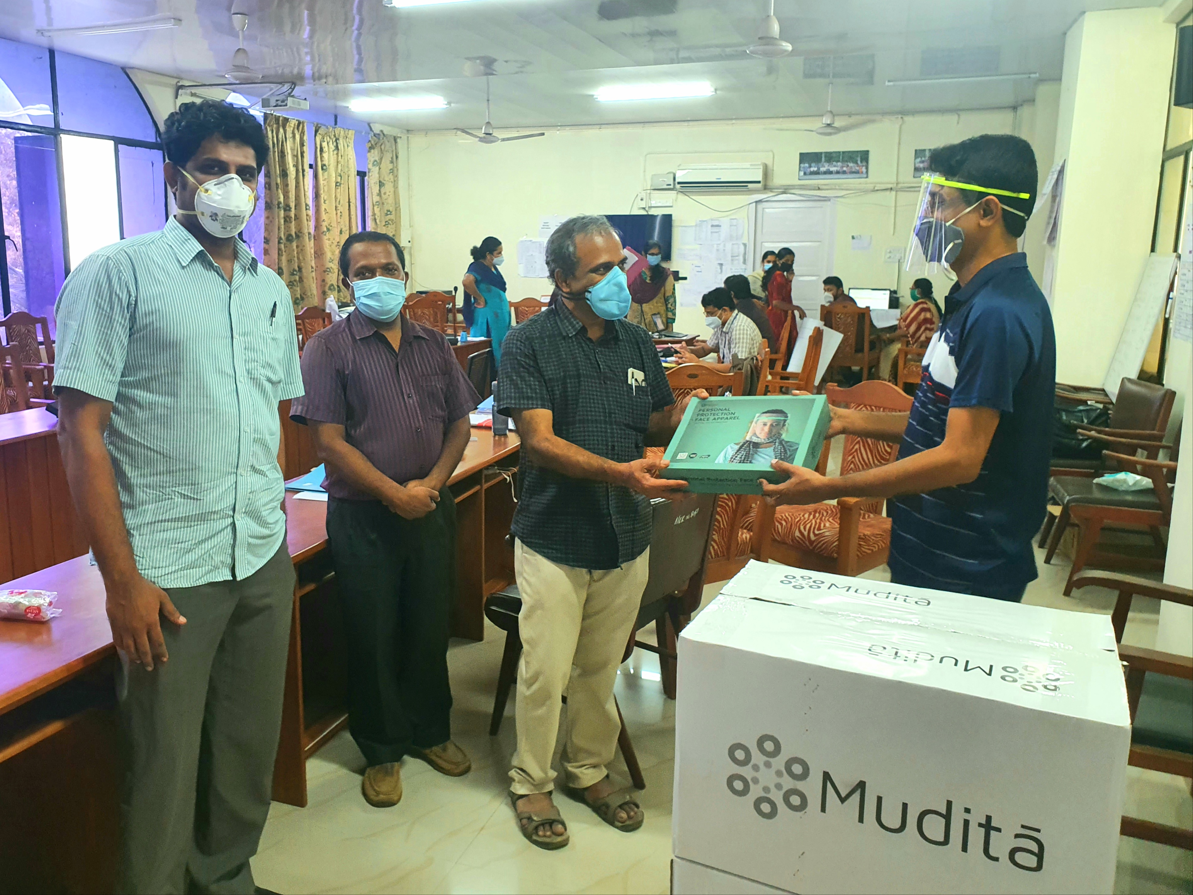 Handing over 1000 Mudita face apparels to Dr. Jayakumar, superintendent Govt Medical College, Kottayam. Sponsored by an well known industrialist from Kottayam.